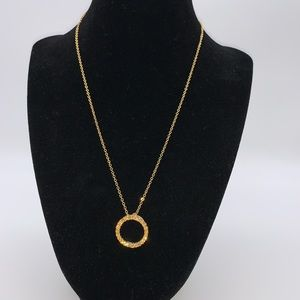 Jewelry - Gold tone necklace with yellow-orange pendant